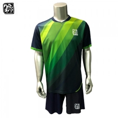 kits de football sublimés par marine et vert de colorant uniformes de football